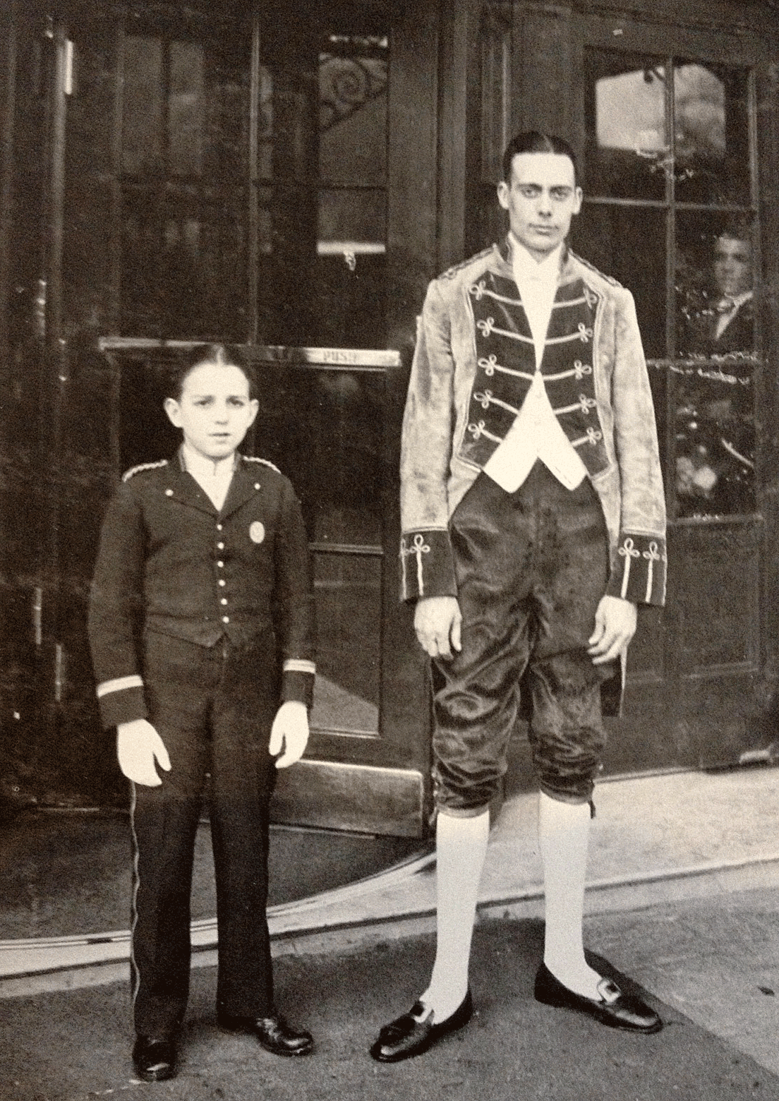 Footman and bellboy in front of The Savoy, London
